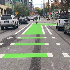 A green-painted bike lane extending through an intersection