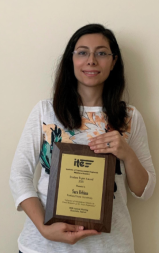 Sarah Urbina holding her OR ITE award plaque