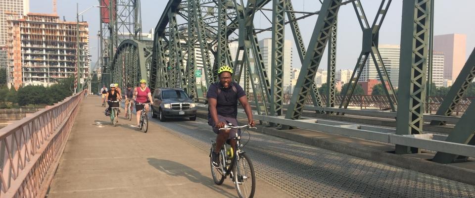 Cyclists ride on the Hawthorne Bridge