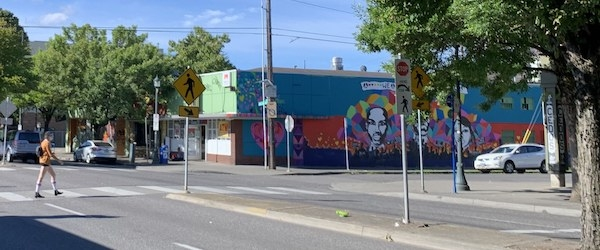 View of North MLK Boulevard in Portland, Oregon with a pedestrian crossing near a mural.