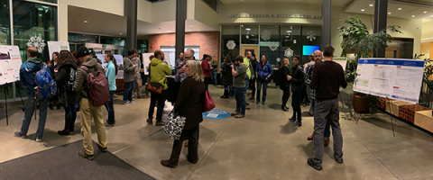 People looking at posters in the Engineering Building Atrium at TRB aftershock 2019
