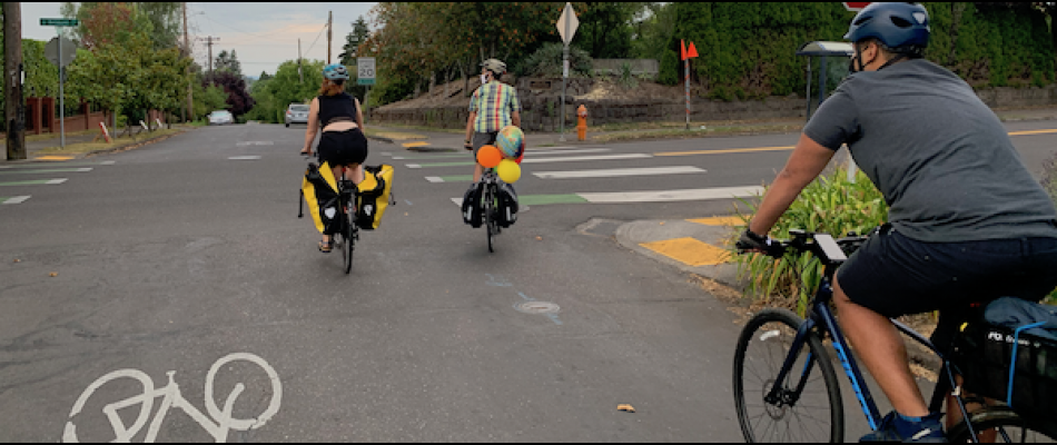 Cyclists ride along a bicycle boulevard in Portland, Oregon
